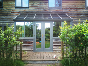 Grey painted lean-to timber conservatory